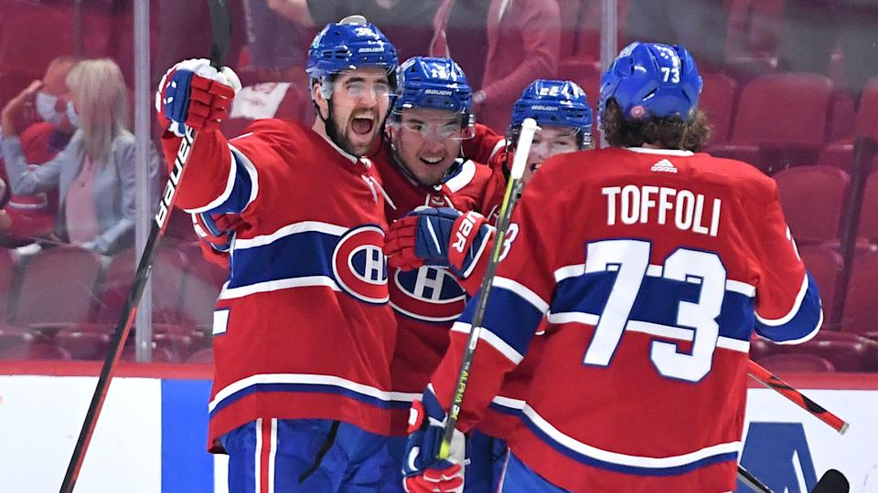 MONTREAL, QC - June 7: Erik Gustafsson #32 and Nick Suzuki #14 of the Montreal Canadiens celebrate after scoring a goal against the Winnipeg Jets in Game Four of the Second Round of the 2021 Stanley Cup Playoffs at the Bell Centre on June 7, 2021 in Montreal, Quebec, Canada. (Photo by Francois Lacasse/NHLI via Getty Images)