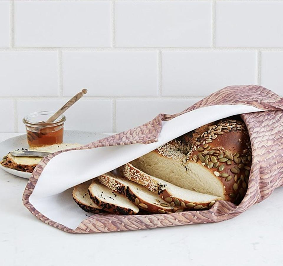 """This heats up in a mere minute so you can enjoy the majesty of fresh! warm! bread!!! for the entirety of your dinner. Psst — you can also try this on loaves that have long since come out of the oven (without doing things that might affect the texture, like using a microwave or oven).<br /><br /><strong>Promising review:</strong>""""This exceeded my expectations. It's big, heavy and sturdy and holds shape however you wrap it. It's a really unique item."""" —Nsartist<br /><br /><strong>Get it from Uncommon Goods for<a href=""""https://uncommongoods.sjv.io/c/468058/483884/8444?subId1=HPEfficientKitchenProducts-60993864e4b0f73e531037cd-&u=https%3A%2F%2Fwww.uncommongoods.com%2Fproduct%2Fbread-warming-blanket"""" target=""""_blank"""" rel=""""noopener noreferrer"""">$30</a>(available in two colors).</strong>"""