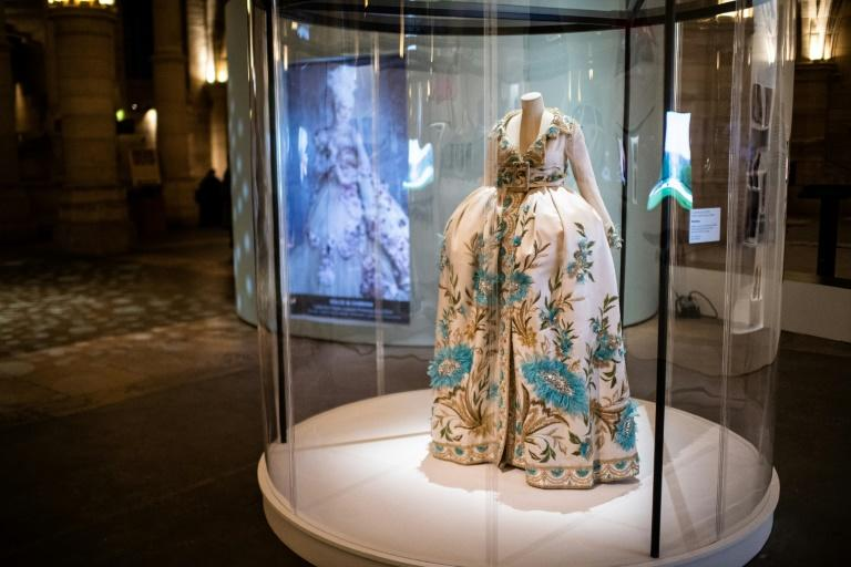 A blue gown worn in the film is part of the display, next to a Christian Dior number inspired by the queen's extravagantmanner of dress