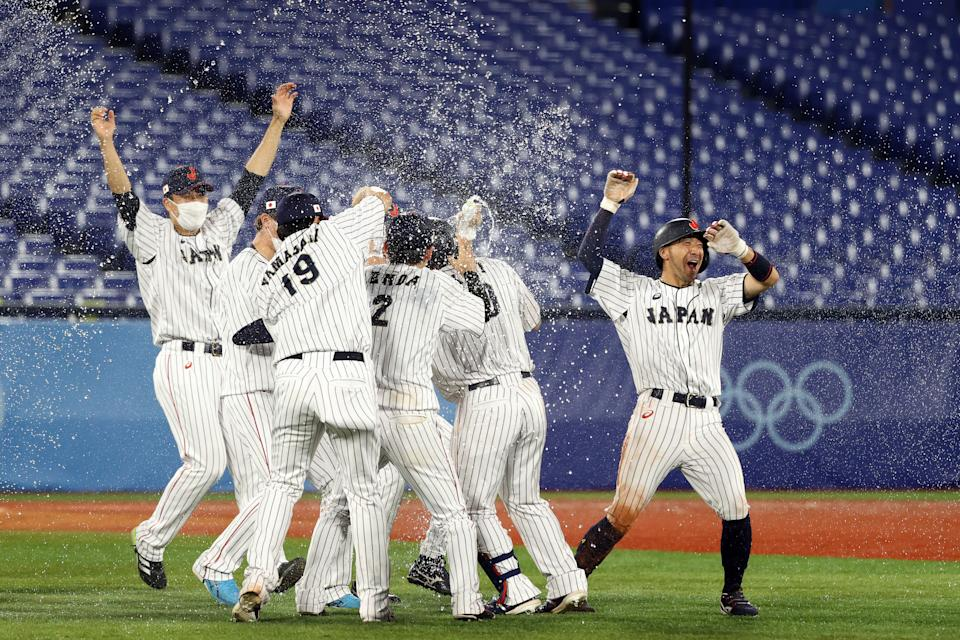 <p>YOKOHAMA, JAPAN - AUGUST 02: Team Japan celebrates after Takuya Kai #10 hit a game-winning single in the tenth inning to defeat Team United States 7-6 during the knockout stage of men's baseball on day ten of the Tokyo 2020 Olympic Games at Yokohama Baseball Stadium on August 02, 2021 in Yokohama, Kanagawa, Japan. (Photo by Koji Watanabe/Getty Images)</p>