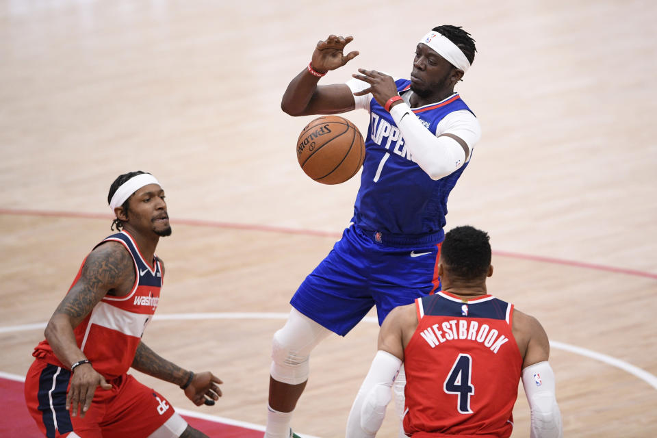 Los Angeles Clippers guard Reggie Jackson (1) loses his grip on the the ball against Washington Wizards guards Bradley Beal, left, and Russell Westbrook (4) during the second half of an NBA basketball game, Thursday, March 4, 2021, in Washington. (AP Photo/Nick Wass)