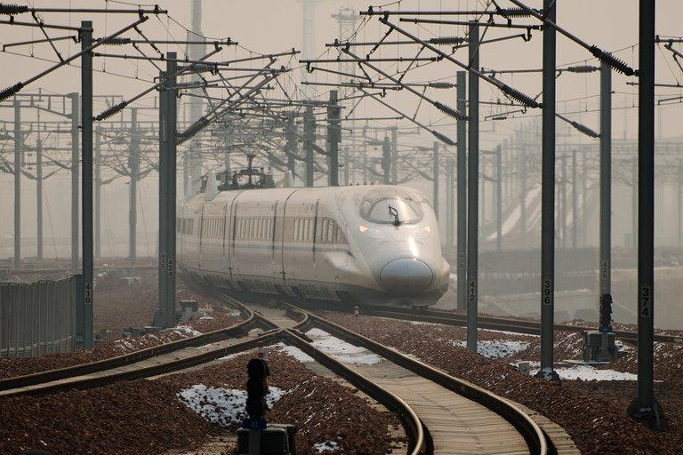 A high-speed train departs a platform in Hebei province, south of Beijing, on December 22, 2012