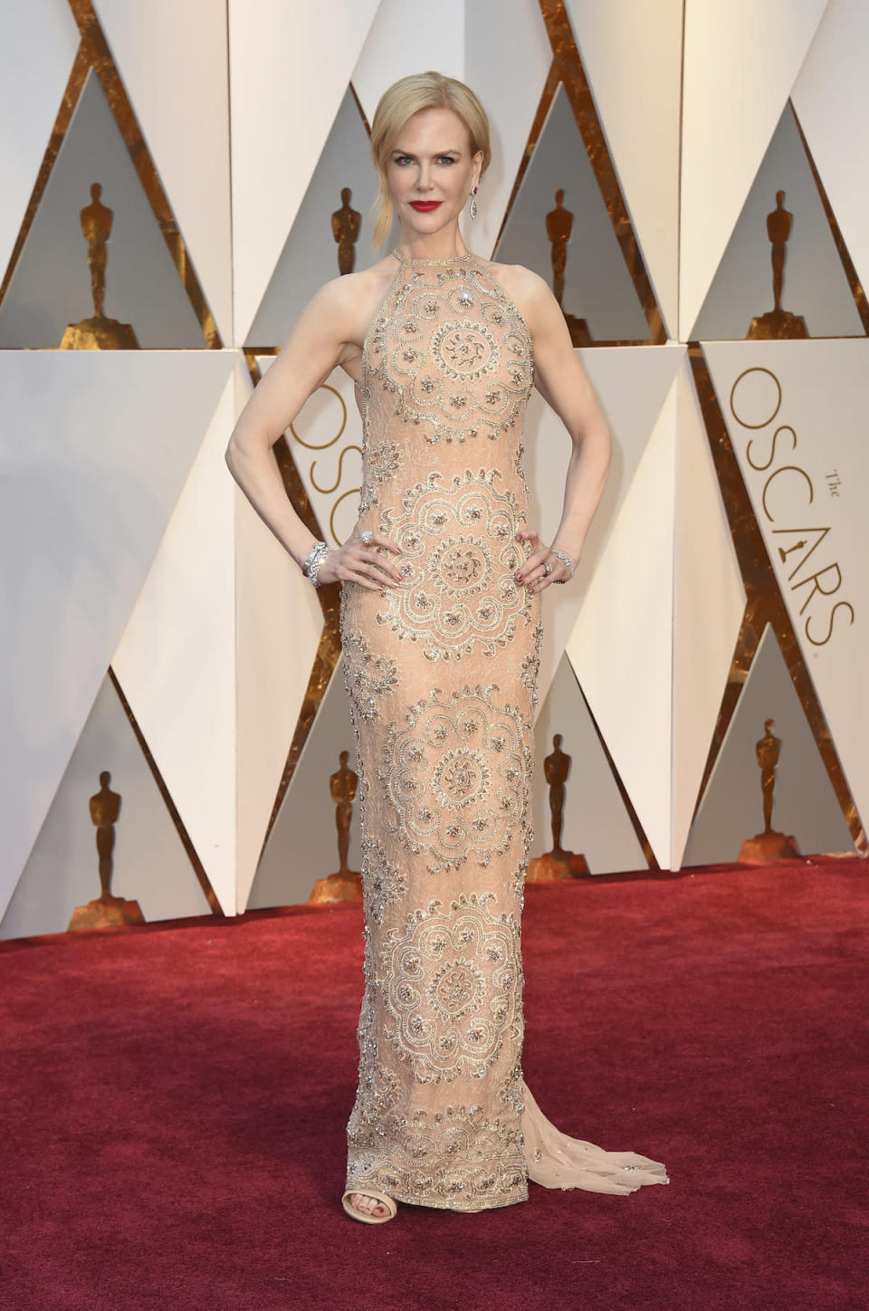 <p>Nicole Kidman has light skin so wearing pale colors is hard, but the actress made it work with a stunning nude gown designed just for her by Armani Privé. <em>(Photo: Getty Images)</em> </p>