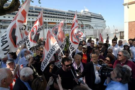 "FILE PHOTO: Members of ""No grandi navi - No big ships"" movement protest in front of the MSC Opera cruise ship that early in the morning crashed against a smaller tourist boat at the San Basilio dock in Venice"
