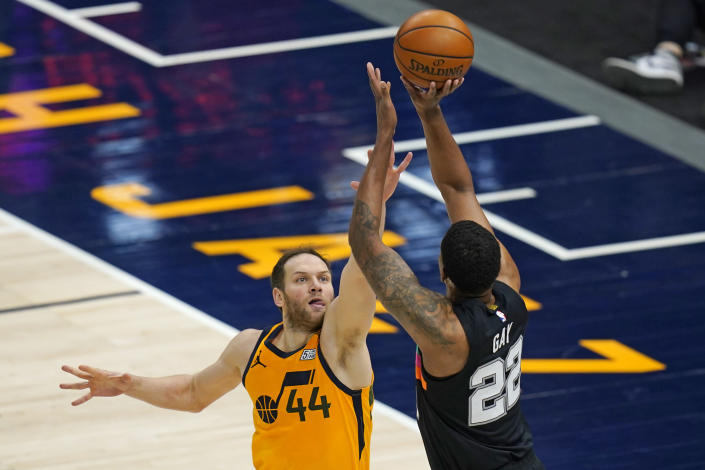 San Antonio Spurs forward Rudy Gay (22) shoots as Utah Jazz forward Bojan Bogdanovic (44) defends in the first half during an NBA basketball game Monday, May 3, 2021, in Salt Lake City. (AP Photo/Rick Bowmer)