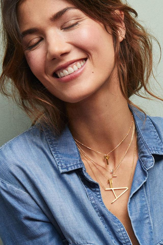 """<p>We love the size of this <a href=""""https://www.popsugar.com/buy/Block-Letter-Monogram-Necklace-526557?p_name=Block%20Letter%20Monogram%20Necklace&retailer=anthropologie.com&pid=526557&price=38&evar1=fab%3Aus&evar9=42665016&evar98=https%3A%2F%2Fwww.popsugar.com%2Ffashion%2Fphoto-gallery%2F42665016%2Fimage%2F46973262%2FBlock-Letter-Monogram-Necklace&list1=shopping%2Cjewelry%2Choliday%2Cgift%20guide%2Choliday%20fashion%2Cfashion%20gifts%2Cgifts%20for%20women%2Cgifts%20under%20%24100&prop13=mobile&pdata=1"""" rel=""""nofollow"""" data-shoppable-link=""""1"""" target=""""_blank"""" class=""""ga-track"""" data-ga-category=""""Related"""" data-ga-label=""""https://www.anthropologie.com/shop/block-letter-monogram-necklace?category=jewelry&amp;color=901&amp;type=STANDARD"""" data-ga-action=""""In-Line Links"""">Block Letter Monogram Necklace</a> ($38).</p>"""