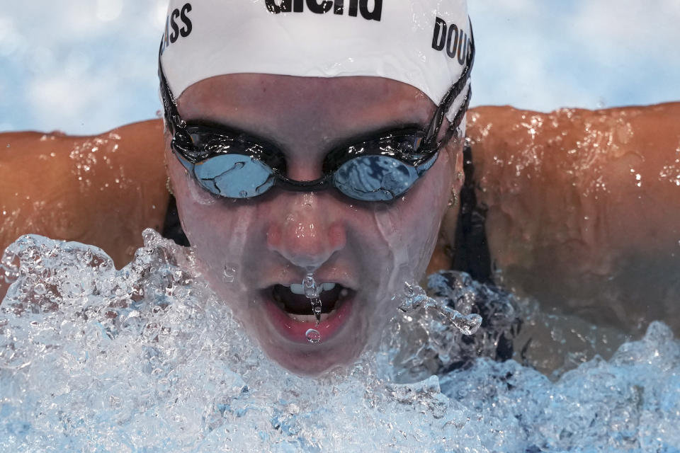 Kate Douglass of the United States swims in a heat during the women's 200-meter individual medley at the 2020 Summer Olympics, Monday, July 26, 2021, in Tokyo, Japan. (AP Photo/Matthias Schrader)