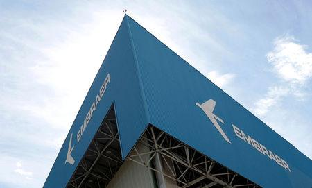 FILE PHOTO: The logo of Brazilian jets maker Embraer is seen on a factory in Sao Jose dos Campos