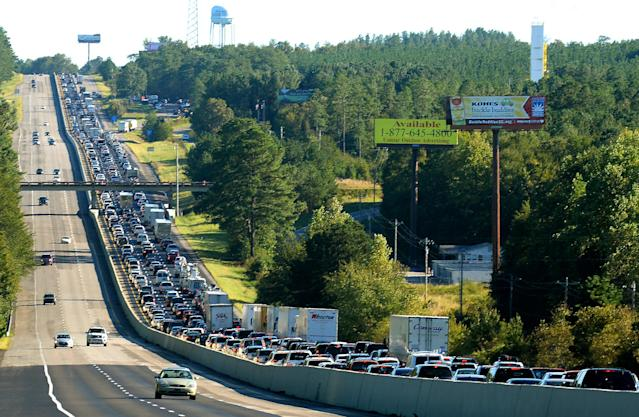 <p>Traffic three-lanes wide slowly moves down I-26 in South Carolina on Sunday, Oct. 9, 2016 as people return to their homes following Hurricane Matthew's path along the Atlantic coast line. The traffic was moved to a snails pace near the exit for Dixiana, S.C. (Photo: Jeff Siner/Charlotte Observer/TNS via Getty Images) </p>
