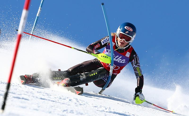 Mikaela Shiffrin, of the United States, speeds down the course during the first run of an alpine ski, women's World Cup slalom, in Courchevel, France, Tuesday, Dec. 17, 2013. (AP Photo/Giovanni Auletta)