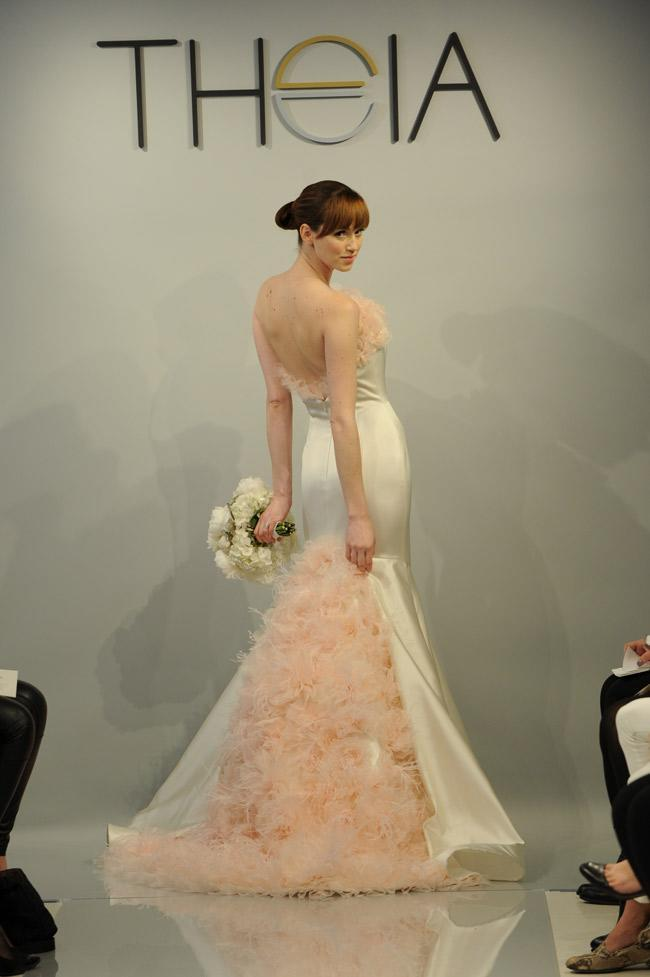 """<div class=""""caption-credit"""">Photo by: Kurt Wilberding / The Knot</div><b>A Pink Train</b> <br> From the front, this Theia gown looks fairly subdued, but the back is a totally different story. Oversized and layered pink rosettes and a fluffy neckline to match make this gown a shoe-in for most daring list. <br>"""