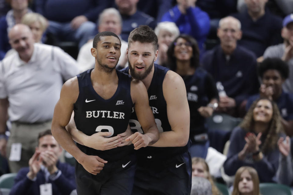 Butler's Aaron Thompson (2) and Bryce Golden (33) near the end of an NCAA college basketball game against Purdue, Saturday, Dec. 21, 2019 in Indianapolis. Butler won 70-61. (AP Photo/Darron Cummings)