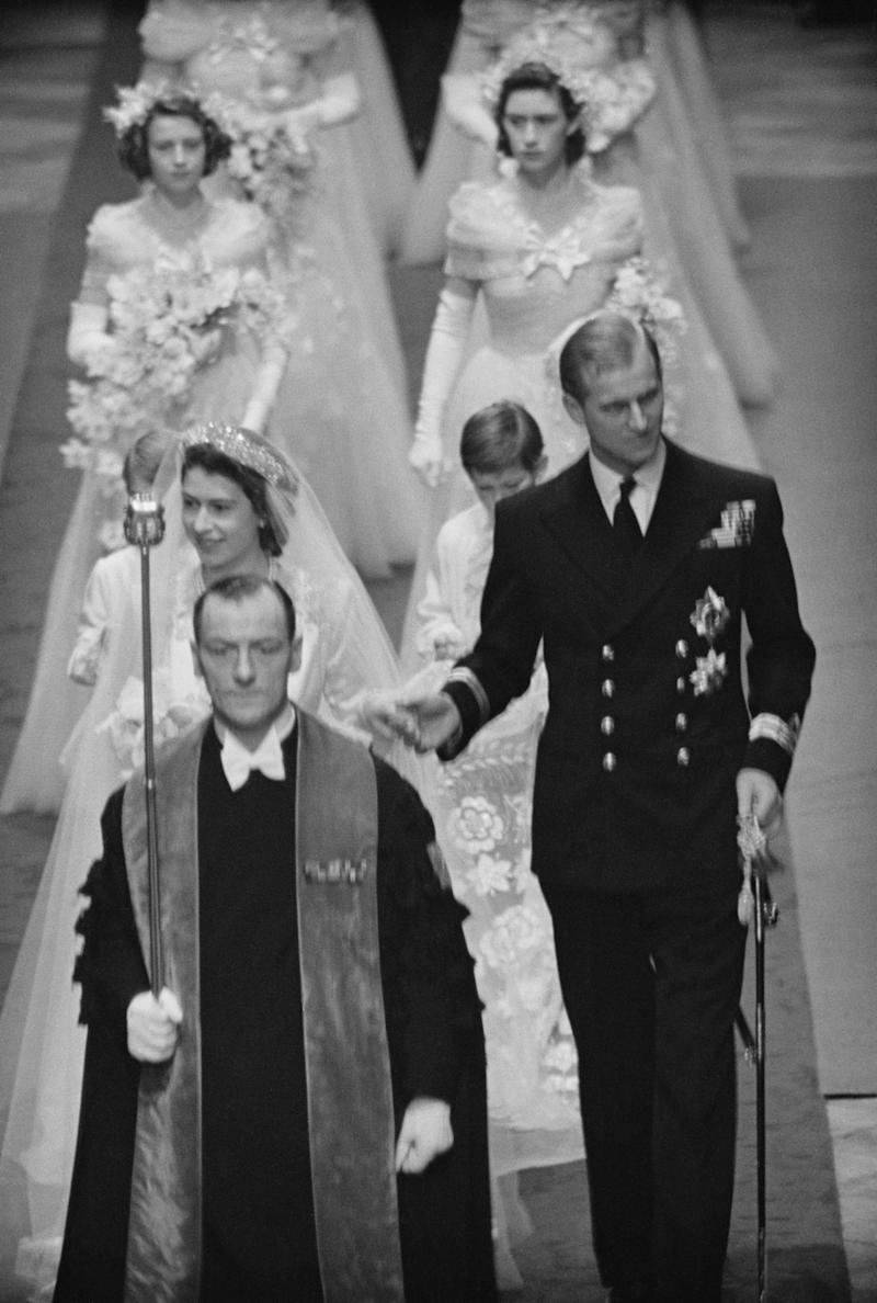 Elizabeth and Philip make their way down the aisle of Westminster Abbey.