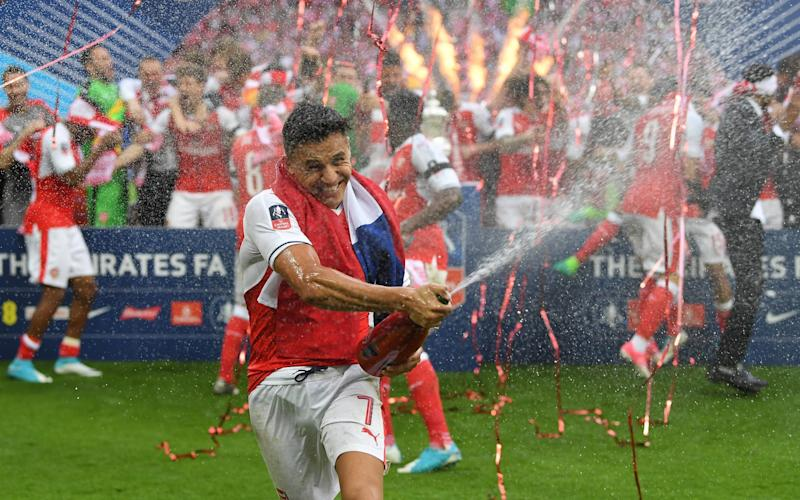 Alexis Sanchez helped Arsenal to FA Cup glory in 2017 - GETTY IMAGES