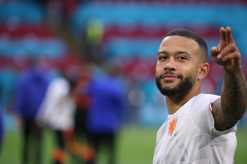 Memphis Depay of the Netherlands celebrates his side's 3-0 win, at the end of the Euro 2020 soccer championship group F match between North Macedonia and Netherlands, at the Johan Cruyff ArenA in Amsterdam, Netherlands, Monday, June 21 2021. (Kenzo Tribouillard/Pool via AP)