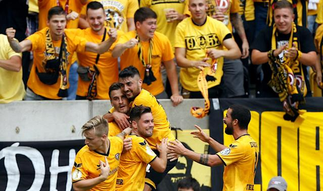 Football Soccer - Dynamo Dresden v RB Leipzig - German Cup (DFB Pokal) - DDV-Stadion, Dresden, Germany - 20/08/16. Dynamo Dresden's Stefan Kuschke (2nd L) and his team mates celebrate after he scored. REUTERS/Axel Schmidt. DFB RULES PROHIBIT USE IN MMS SERVICES VIA HANDHELD DEVICES UNTIL TWO HOURS AFTER A MATCH AND ANY USAGE ON INTERNET OR ONLINE MEDIA SIMULATING VIDEO FOOTAGE DURING THE MATCH.