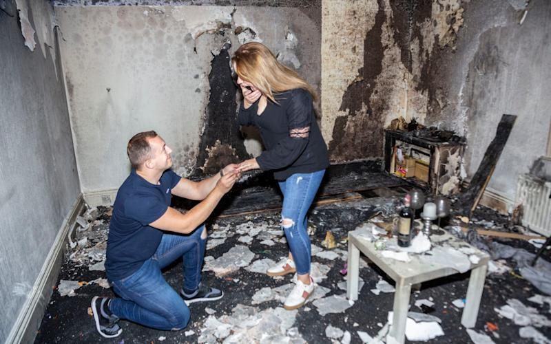 Albert Ndreu proposed anyway in the torched flat - and she said yes - SWNS