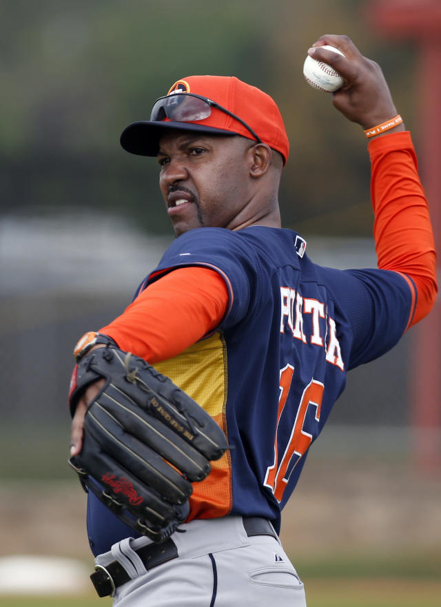 Houston Astros manager Bo Porter throws before a spring training baseball workout, Friday, Feb. 21, 2014, in Kissimmee, Fla. (AP Photo/Alex Brandon)