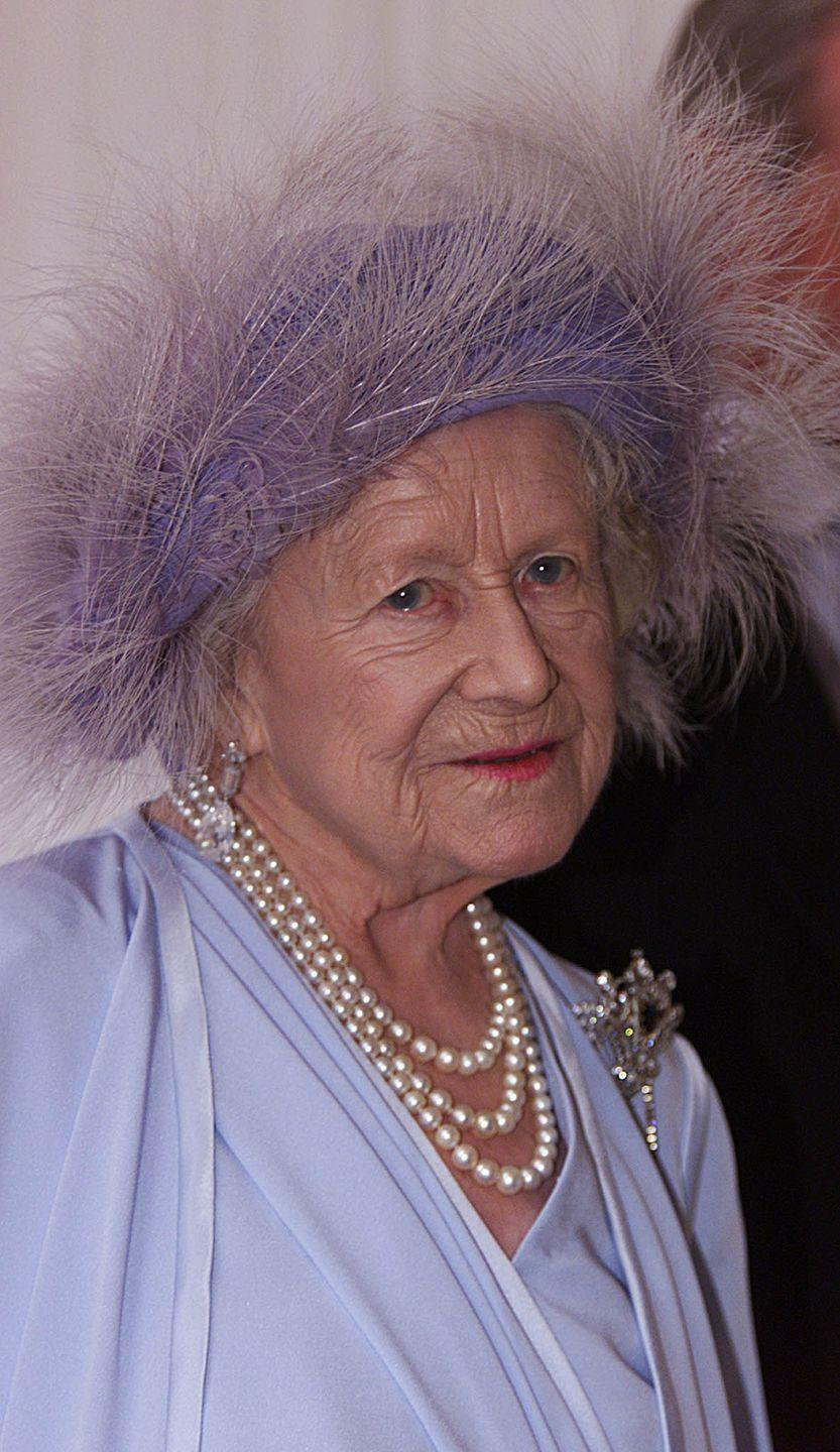<p>The Queen Mother arrives at Prince Edward's wedding to Sophie Rhys-Jones in an all-purple ensemble complete with feathered hat.</p>