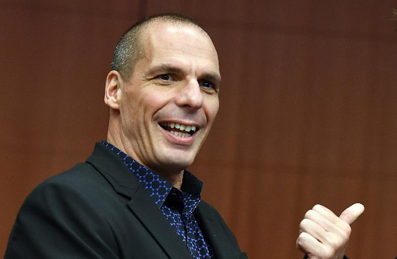 Greek Finance Minister Yanis Varoufakis gestures before the start of a meeting of Eurogroup finance ministers in Brussels, on March 9, 2015 (AFP Photo/Emmanuel Dunand)