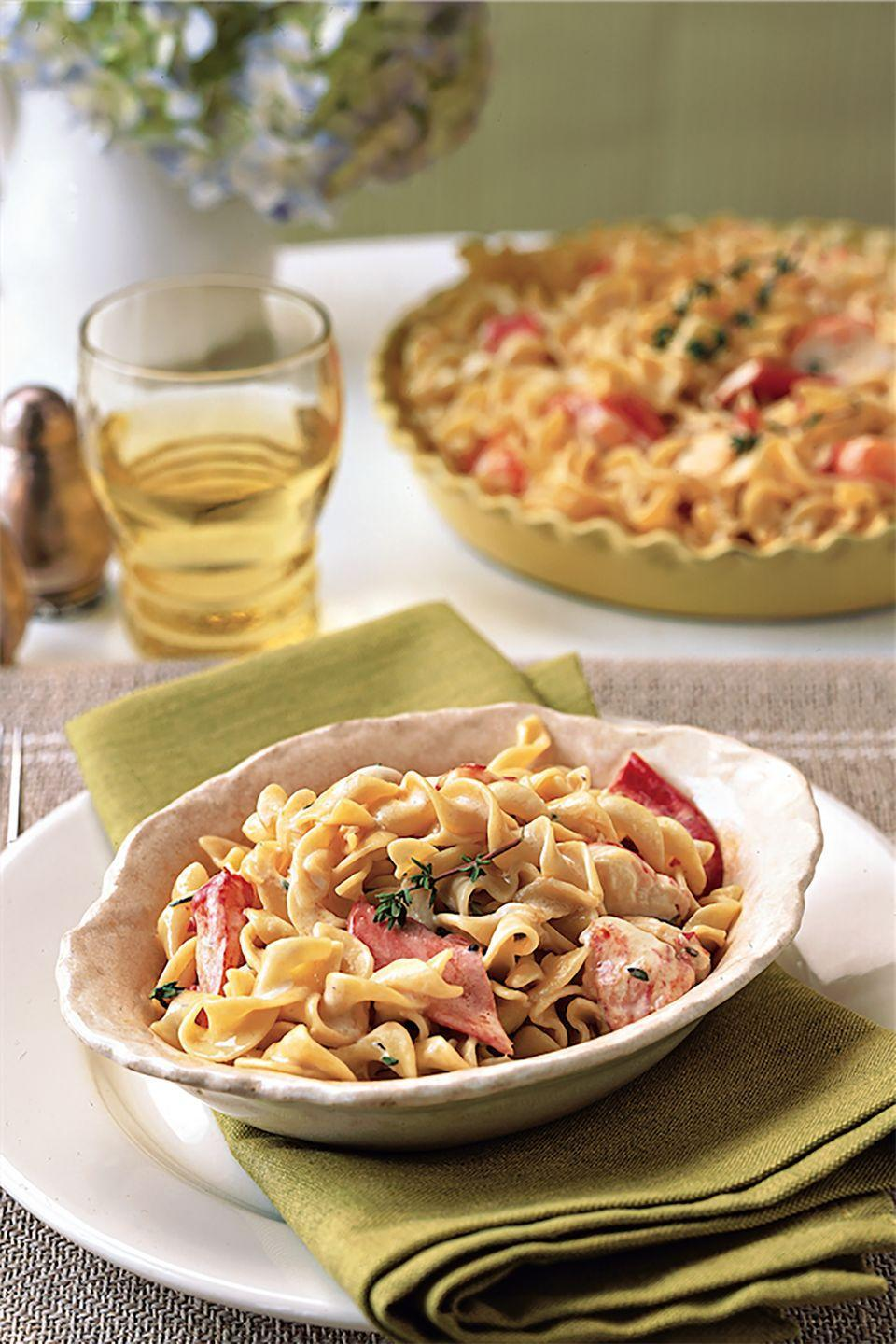 """<p>This elegant casserole was inspired by the tuna-noodle childhood favorite. It can be baked in individual casseroles or in one large dish and served buffet style. </p><p><strong><a href=""""https://www.countryliving.com/food-drinks/recipes/a1704/lobster-noodle-casserole-3829/"""" rel=""""nofollow noopener"""" target=""""_blank"""" data-ylk=""""slk:Get the recipe"""" class=""""link rapid-noclick-resp"""">Get the recipe</a>.</strong></p>"""