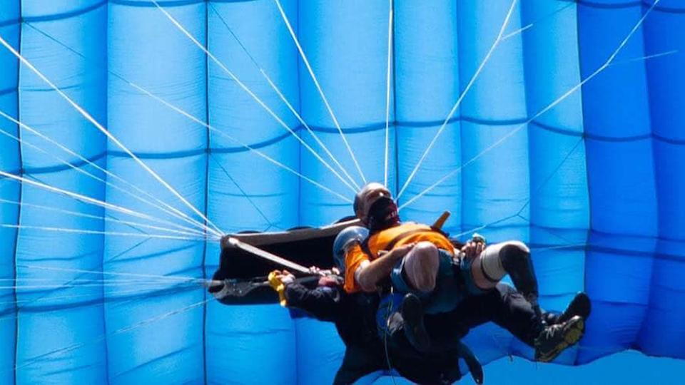Double amputee Chris Marckres is pictured skydiving just after he lost one of his prosthetic legs.