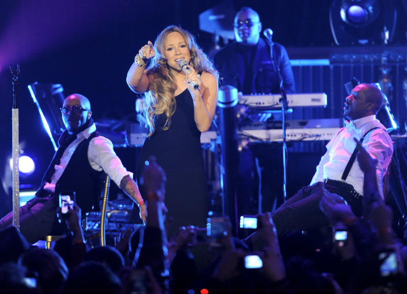"""Singer Mariah Carey performs at Caesars Entertainment """"Escape to Total Rewards"""" kick-off at Gotham Hall on Thursday, March 1, 2012 in New York. (AP Photo/Evan Agostini)"""