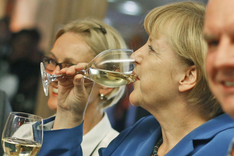 German Chancellor Angela Merkel, chairwoman of the Christian Democratic party CDU drinks a glass of withe wine at the party headquarters after the national elections in Berlin Sunday, Sept. 22, 2013. Chancellor Angela Merkel's conservatives triumphed in Germany's election Sunday, and could even win the first single party majority in more than 50 years. Her center-right coalition partners risked ejection from parliament for the first time in their post-World War II history.(AP Photo/Markus Schreiber)