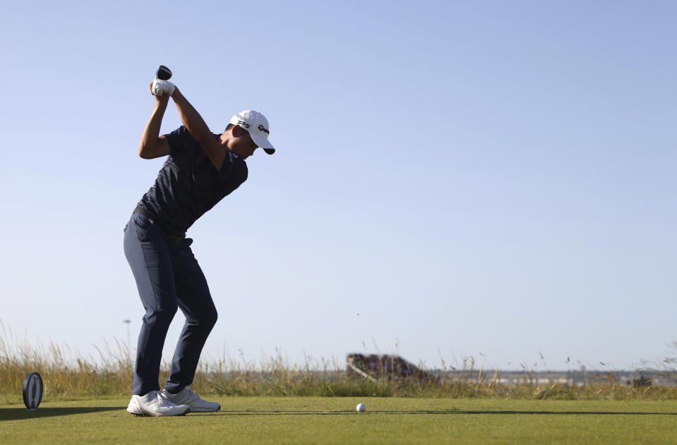 United States' Collin Morikawa plays his tee shot on the 11th hole during the third round of the British Open Golf Championship at Royal St George's golf course Sandwich, England, Saturday, July 17, 2021. (AP Photo/Peter Morrison)
