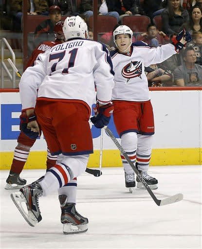 Columbus Blue Jackets' Matt Calvert, right, celebrates his goal with teammate Nick Foligno (71) against the Phoenix Coyotes during the first period, Saturday, Feb. 16, 2013, in Glendale, Ariz. (AP Photo/Matt York)