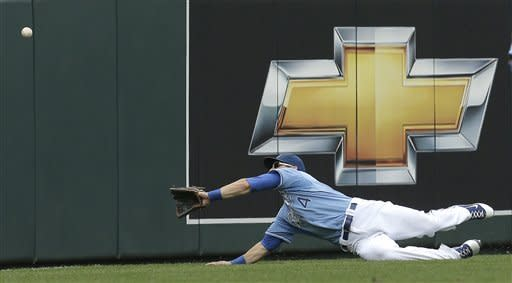 Kansas City Royals left fielder Alex Gordon chases after a double hit by Los Angeles Angels' Erick Aybar during the first inning of a baseball game on Sunday, Sept. 16, 2012, in Kansas City, Mo. (AP Photo/Charlie Riedel)