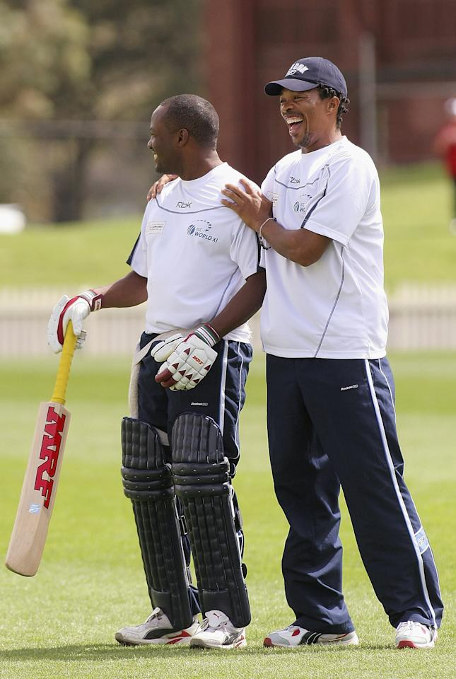 MELBOURNE, AUSTRALIA - SEPTEMBER 30: Brian Lara of the West Indies and Makhaya Ntini of South Africa have a laugh during ICC World Xl Squad training at Junction Oval September 30, 2005 in Melbourne, Australia. (Photo by Quinn Rooney/Getty Images)