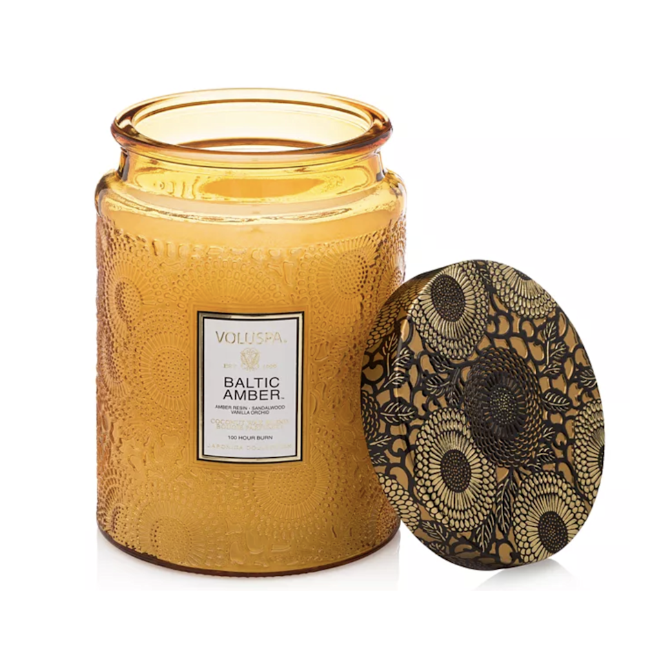 """Although Voluspa has nailed down that summer vacation smell, its Baltic Amber candle encases us in a more subdued spiciness (its amber resin and sandalwood notes) that's uplifted by vanilla orchid so that we're not getting a scent that's too one-sided. Of course, keep the jar as soon as you're done. It's begging for some freshly cut flowers, or a stash of your favorite pens. $26, Amazon. <a href=""""https://www.amazon.com/Voluspa-Scalloped-Glass-Candle-Baltic/dp/B00UVQI0L4/ref=asc_df_B00UVQI0L4/"""" rel=""""nofollow noopener"""" target=""""_blank"""" data-ylk=""""slk:Get it now!"""" class=""""link rapid-noclick-resp"""">Get it now!</a>"""