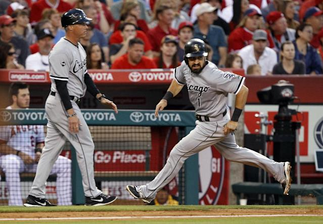 Chicago White Sox's Adam Eaton (1) rounds third to score on a single by Gordon Beckham, with third base coach Joe McEwing, left, watching in the third inning of a baseball game against the Los Angeles Angels on Saturday, June 7, 2014 in Anaheim, Calif. (AP Photo/Alex Gallardo)