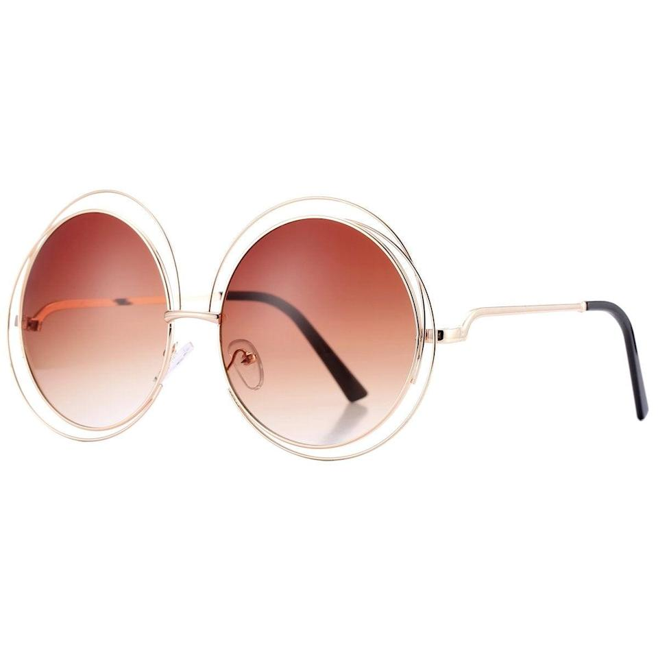 """<h2>Pro Acme Double Circle Metal Wire Frame</h2><br>You may or may not be giving rock and roll vibes with these glam circular shades that even John Lennon would ask to borrow. <br><br><strong>The Hype: </strong>4.4 out of 5 stars and 706 reviews<br><br><strong>What They Are Saying:</strong> """"My friend owned a pair and I knew I had to have them as soon as I saw her wear them! I Have worn these often for over a year and they are still holding strong. They are big and a lil """"loud"""" but I get compliments all the time and I always say, 'Thanks, I call them my Elton John sunglasses!'"""" - Erin<br><br><em>Shop</em> <strong><em><a href=""""https://amzn.to/3vtGbDP"""" rel=""""nofollow noopener"""" target=""""_blank"""" data-ylk=""""slk:Pro Acme"""" class=""""link rapid-noclick-resp"""">Pro Acme </a></em></strong><br><br><strong>Acme</strong> Pro Acme Women's Double Circle Metal Wire Frame Oversized Round Sunglasses, $, available at <a href=""""https://amzn.to/3zkfDYS"""" rel=""""nofollow noopener"""" target=""""_blank"""" data-ylk=""""slk:Amazon"""" class=""""link rapid-noclick-resp"""">Amazon</a>"""