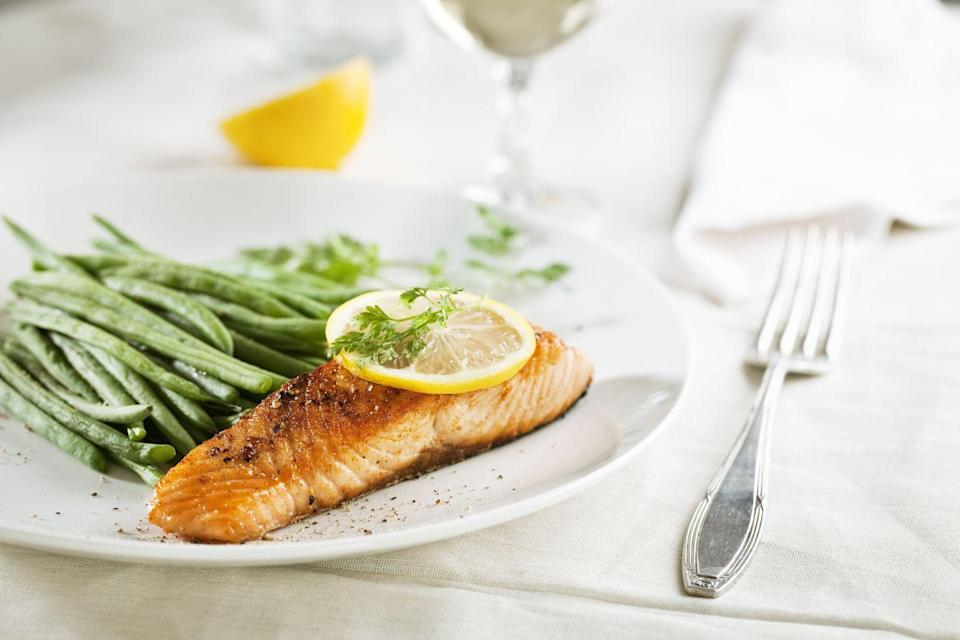 """<p><strong>Weekly servings to aim for:</strong> 1</p><p><strong>One serving equals: </strong>3 to 4 ounces</p><p>Salmon is an especially smart choice as it's rich in omega-3 fatty acids, which <a href=""""https://n.neurology.org/content/78/23/1832"""" rel=""""nofollow noopener"""" target=""""_blank"""" data-ylk=""""slk:research shows"""" class=""""link rapid-noclick-resp"""">research shows</a> may lower your risk of Alzheimer's disease.<br></p>"""