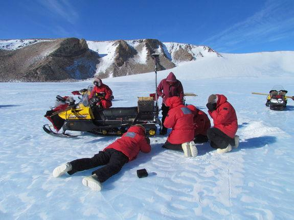 Scientists work to gather meteorites in this scene from a recent meteorite-hunting season of the Antarctic Search for Meteorites Program run by Case Western Reserve University.