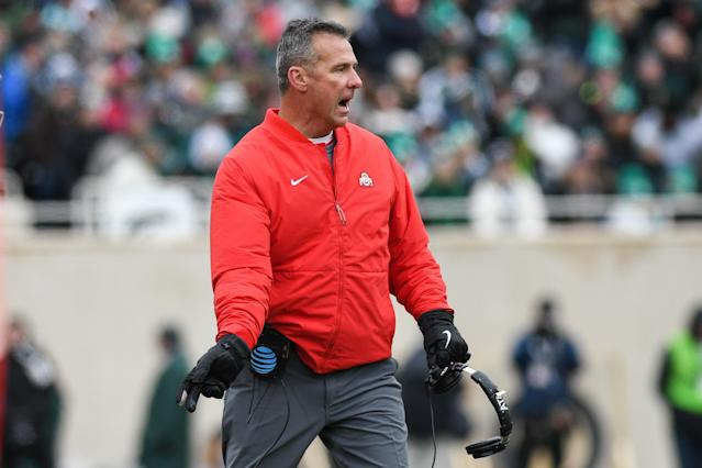 "<a class=""link rapid-noclick-resp"" href=""/ncaaf/teams/ohio-st/"" data-ylk=""slk:Ohio State Buckeyes"">Ohio State Buckeyes</a> head coach Urban Meyer yells toward his team during a Big Ten college football game (Getty)"