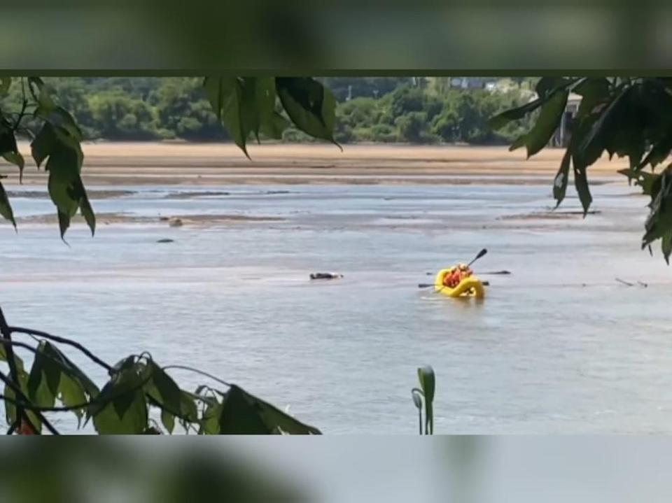 Rescuers from Tulsa Fire Department in Oklahoma were summoned to retrieve a body only to find it was a man napping in the Arkansas River. — Screen capture from Twitter/ Tulsa Fire Dept