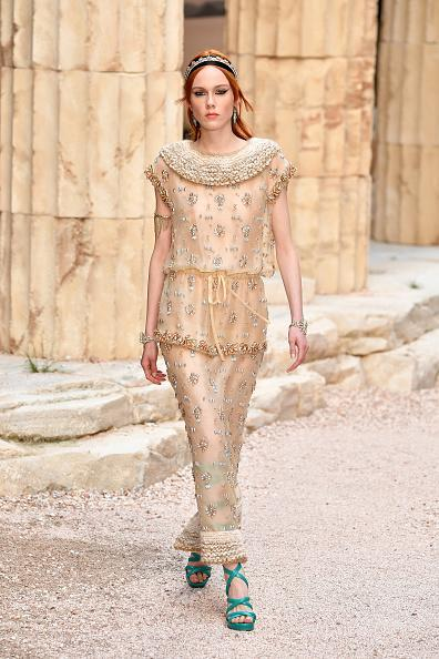 <p>A model in a delicately embroidered dress walks the runway during Chanel Cruise 2018 Collection at Grand Palais in Paris. (Photo: Getty Images) </p>