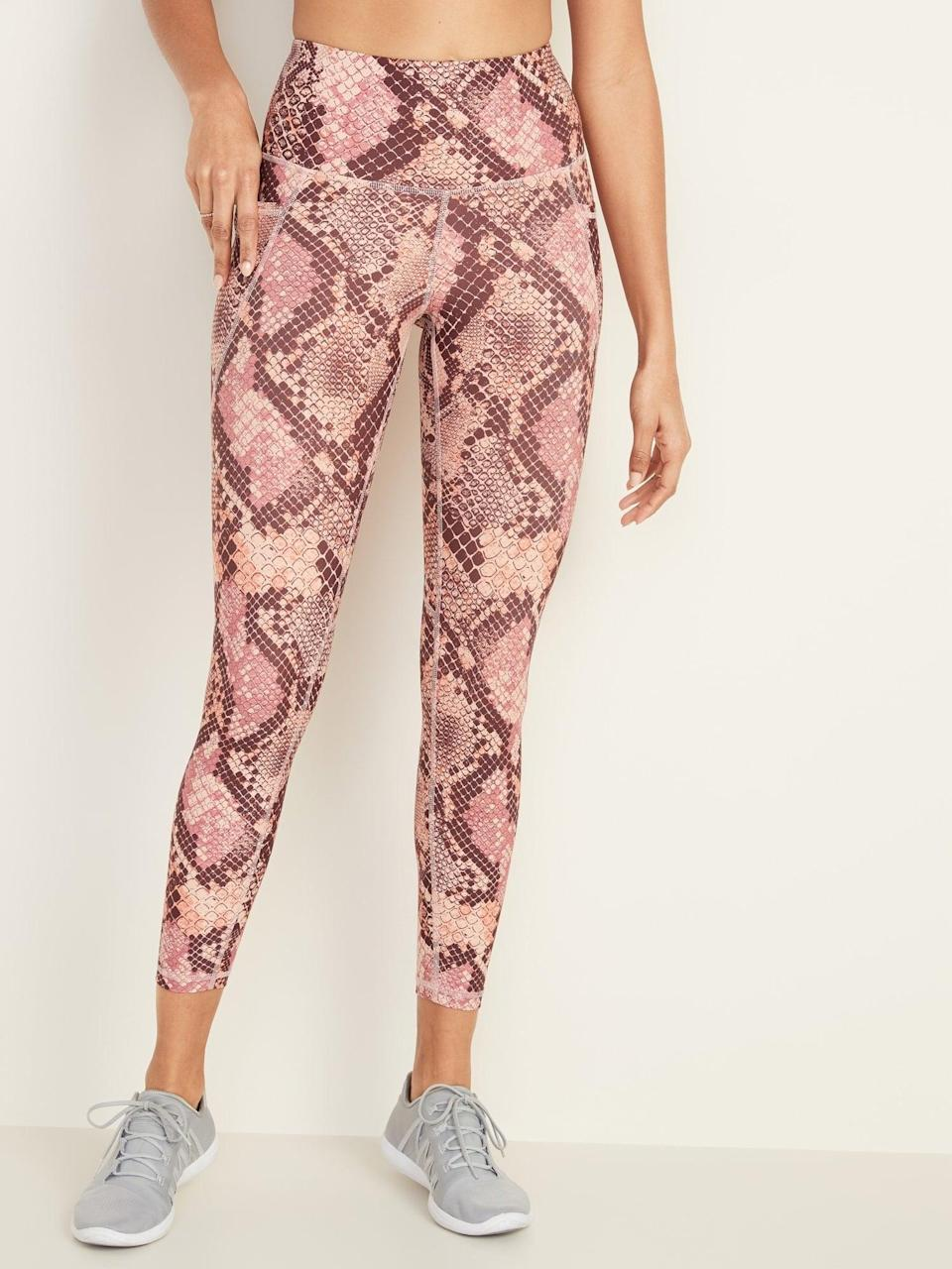 """<p>If you're looking for a pattern pair of leggings, opt for these <a href=""""https://www.popsugar.com/buy/Old-Navy-High-Waisted-Elevate-Powersoft-78-Length-Side-Pocket-Leggings-547979?p_name=Old%20Navy%20High-Waisted%20Elevate%20Powersoft%207%2F8-Length%20Side-Pocket%20Leggings&retailer=oldnavy.gap.com&pid=547979&price=37&evar1=fit%3Aus&evar9=47203531&evar98=https%3A%2F%2Fwww.popsugar.com%2Ffitness%2Fphoto-gallery%2F47203531%2Fimage%2F47203532%2FOld-Navy-High-Waisted-Elevate-Powersoft-78-Length-Side-Pocket-Leggings&list1=old%20navy%2Cworkout%20clothes%2Ceditors%20pick%2Cfitness%20gear%2Cfitness%20shopping&prop13=mobile&pdata=1"""" class=""""link rapid-noclick-resp"""" rel=""""nofollow noopener"""" target=""""_blank"""" data-ylk=""""slk:Old Navy High-Waisted Elevate Powersoft 7/8-Length Side-Pocket Leggings"""">Old Navy High-Waisted Elevate Powersoft 7/8-Length Side-Pocket Leggings</a> ($37, originally $40) in the pink snake-print choice.</p>"""