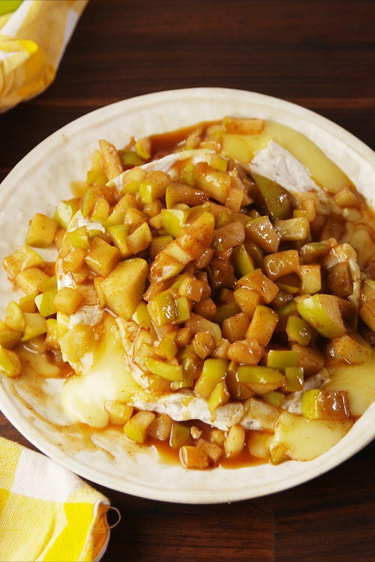 """<p>Baked brie with a fun fall twist.</p><p>Get the recipe from <a href=""""https://www.delish.com/cooking/recipe-ideas/recipes/a56279/caramel-apple-brie-recipe/"""" rel=""""nofollow noopener"""" target=""""_blank"""" data-ylk=""""slk:Delish"""" class=""""link rapid-noclick-resp"""">Delish</a>. </p>"""