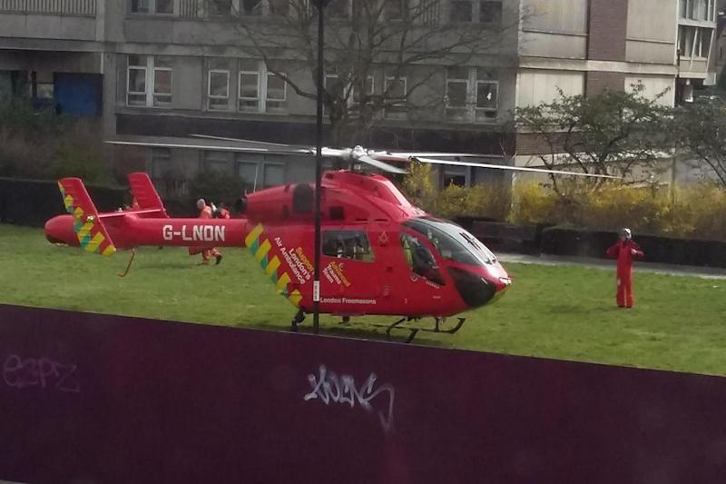 Stabbing: The air ambulance landed at the scene: Facebook / Catherine Stephenson / Street Trails