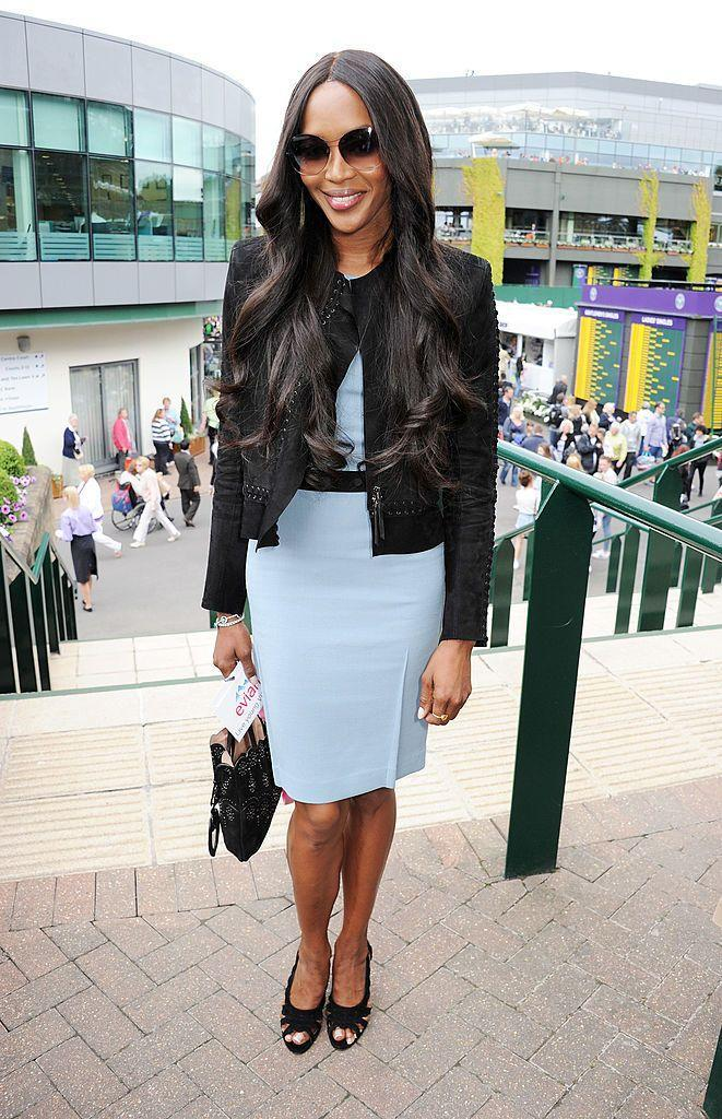 <p>The supermodel paired her sky blue dress with a cropped black jacket. </p>