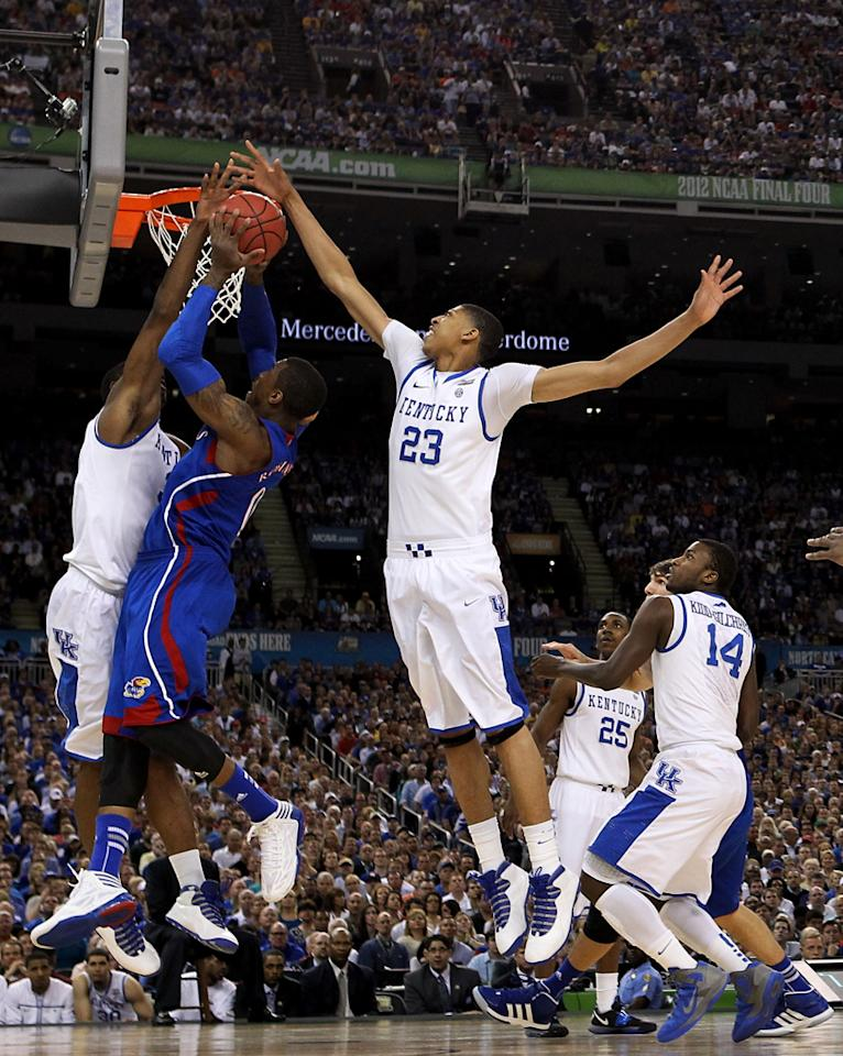 Thomas Robinson #0 of the Kansas Jayhawks goes up for a shot against Terrence Jones #3 and Anthony Davis #23 of the Kentucky Wildcats in the first half in the National Championship Game of the 2012 NCAA Division I Men's Basketball Tournament at the Mercedes-Benz Superdome on April 2, 2012 in New Orleans, Louisiana. (Photo by Ronald Martinez/Getty Images)