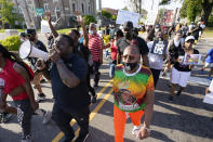 FILE - In this April 28, 2021 file photo, protesters march along the streets to protest the shooting of Andrew Brown Jr. in Elizabeth City, N.C. The fatal shooting of a Black man by sheriff's deputies has sent shock waves through Elizabeth City. The majority Black city in the state's rural northeastern corner holds an important place in African American history in the 19th and 20th centuries. But some residents say it seemed too close-knit and too out-of-the-way to become a flashpoint in the 21st. (AP Photo/Steve Helber, File)