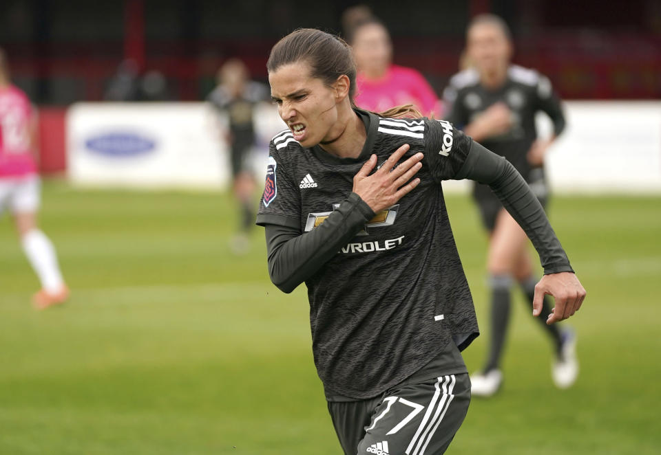 Manchester United's Tobin Heath celebrates scoring against West Ham United during the FA Women's Super League match at Victoria Road Stadium, London, Sunday Oct. 18, 2020. (John Walton/PA via AP)
