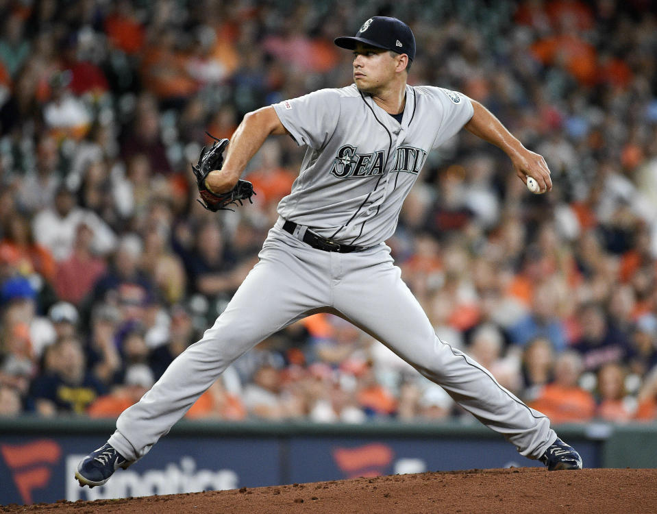 Seattle Mariners starting pitcher Marco Gonzales delivers during the first inning of a baseball game against the Houston Astros, Sunday, June 30, 2019, in Houston. (AP Photo/Eric Christian Smith)