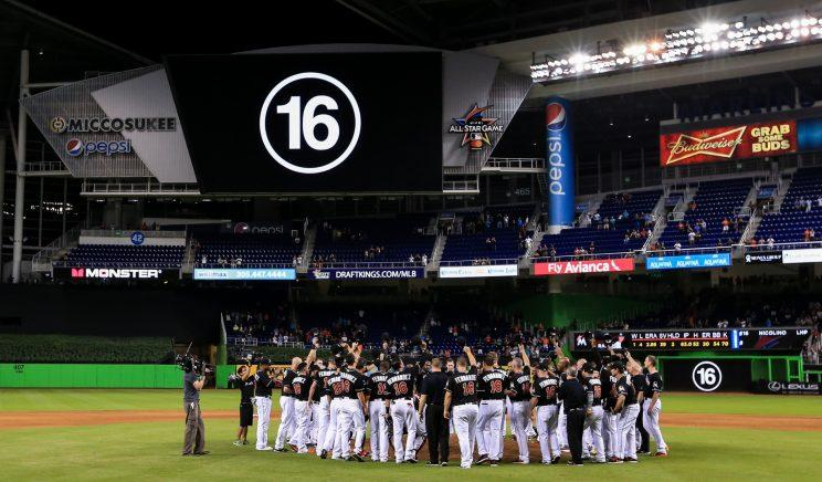 Miami Marlins players all wearing jerseys bearing the number 16 and name Fernandez honor the late Jose Fernandez after the game against the New York Mets at Marlins Park on September 26, 2016 in Miami, Florida. (Photo by Rob Foldy/Getty Images)