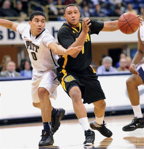 Pittsburgh's James Robinson, left, guards Kennesaw State's Myles Hamilton, right, who looks to pas the ball in the first half of an NCAA basketball game in Pittsburgh, Sunday, Dec. 23, 2012. (AP Photo/John Heller)